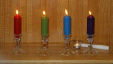 Lit candles for each of the four Assembly sites