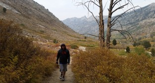 Austin hiking in Lamoille Canyon with a tiny view of our RV